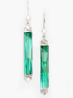 Green tourmaline and diamond drop earrings set with carr? and single cut diamonds in 18ct white gold.  A very rare pair, and hard to find.