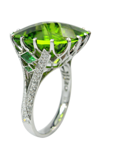Handmade Peridot, Diamond and Tsavorite dress ring. Hand pierced setting with calibre cut tsavorites in the shoulders.