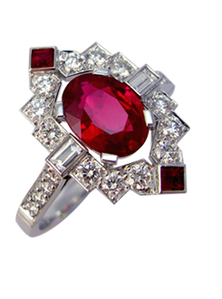 Art Deco inspired ruby and diamond dress ring. Geometrical design with pavae and baguette shoulders and pavae and ruby surround.