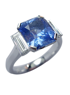 Radiant cut Ceylon sapphire and diamond dress ring. Modern clean lines design with baguette diamond shoulders.