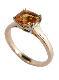 Imperial topaz set in fine Platinum split claw setting, and complementing 18 carat rose gold shank.