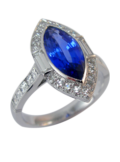 Art Deco inspired marque cut Ceylon sapphire and diamond ring. Diamond baguette and single cut diamond pavae surround and carre diamond shoulders.