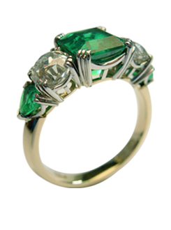 Emerald cut Columbian emerald and diamond ring, handmade in platinum and 18 carat yellow gold with fine inlayed detail.