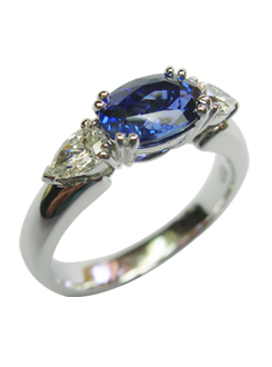 Sapphire and diamond dress ring, handmade in 18 carat white gold, with stones set across the finger in fine split claws.