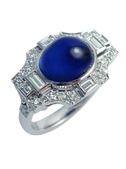 Art Deco design cabochon sapphire and diamond ring. With diamond baguettes and pavae single cut diamonds, very fine attention to detail.