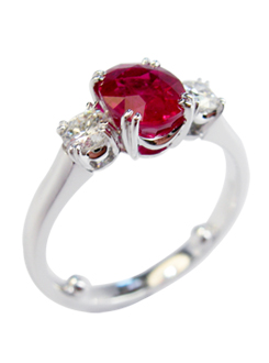 Handmade 18 carat white gold Burmese ruby and diamond engagement ring, with fine under rail and split claws.