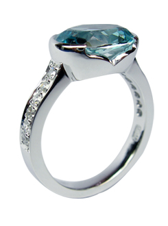 Aquamarine and diamond dress ring. Stones set across the finger. Semi-bezel set aquamarine with thread set shoulders.