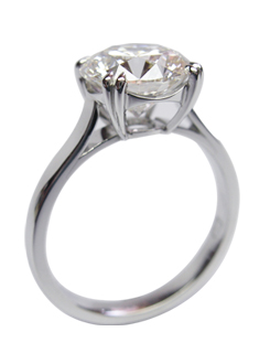 Solitare diamond engagement ring. Very fine 4 claw split claw and curved under rail handcrafted in platinum.