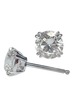 Round brilliant cut diamond stud earrings set in a fine split four claw setting.