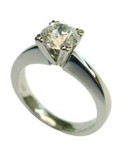 Platinum and Diamond engagement ring handcrafted in a split claw four claw setting.