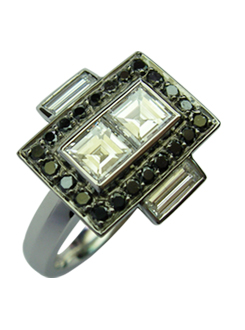 Art deco inspiration with a modern twist. White and black diamond ring. Two carre diamonds surrounded by black diamonds and diamond baguettes, set across the finger.