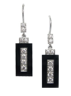 Diamond and onyx drop earrings. A thread set center surrounded by a floating onyx surround.