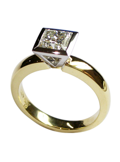 Diamond solitaire engagement ring. Handmade in 18 carat gold with a princess cut diamond in a bold bezel design.