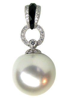 South sea pearl, diamond and faceted onyx pendant in a very fine antique design.